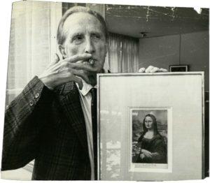 """Portrait of Marcel Duchamp with his work """"L.H.O.O.Q."""", ©Nat Fein, Vente Me Le Mouël, Mme Esders, Drouot, Paris, 1965."""