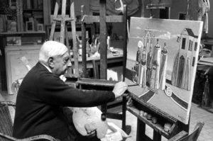 Giorgio de Chirico nel suo studio.